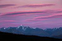 Pink colored lenticular clouds over the Alaska Range mountains in Denali National Park, Interior, Alaska