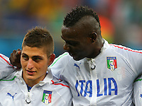 Mario Balotelli of Italy pulls the ear of Marco Verratti as the teams line up