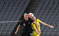 21st July 2021. Tokyo, Japan; Clare Polkinghorne of Autralia challenges Hannah Wilkinson of New Zealand during for womens football match G match between Australia and New Zealand at Tokyo 2020 in Tokyo, Japan