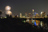 On July 4th, thousands people gather at Auditorium Shores for the largest Independence Day celebration in Austin for an Austin Symphony July 4th Concert and spectacular fireworks over Lady Bird Lake in downtown Austin, Texas.