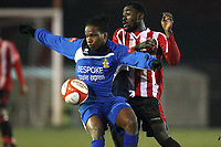 Orlando Smith of Aveley shields the ball from Tambeson Eyong of Hornchurch - AFC Hornchurch vs Aveley - Ryman League Premier Division Football at The Stadium - 08/03/11 - MANDATORY CREDIT: Gavin Ellis/TGSPHOTO - Self billing applies where appropriate - Tel: 0845 094 6026