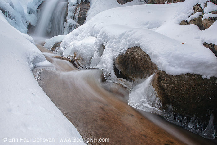 Swiftwater Falls on Dry Brook in Franconia Notch in Lincoln, New Hampshire during the winter months. The Falling Waters Trail passes by it.