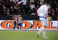 FC Dallas (33) Kenny Cooper  can't look as Chivas USA (middle) Alecko Eskandarian gets hugs from teammates after scoring a goal in the second half during a game at the Home Depot Center in Carson, CA on Saturday, April 25, 2009..