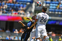 SAN JOSE, CA - JUNE 8: Chris Wondolowski #8 goes up for a header with Matt Hedges #24 during a game between FC Dallas and San Jose Earthquakes at Avaya Stadium on June 8, 2019 in San Jose, California.