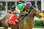 May 1 2010: Buckleupbuttercup with Julien Leparoux up wins the G3 Eight Belles Stakes on a sloppy track at Churchill Downs in Louisville, Kentucky.