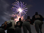 Team USA players watch the fireworks following Game 3 of the annual Collegiate Friendship Series between Team USA and Japan on Tuesday, July 5, 2011. Photo by Al Drago.
