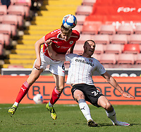 24th April 2021, Oakwell Stadium, Barnsley, Yorkshire, England; English Football League Championship Football, Barnsley FC versus Rotherham United; Mads Juel Andersen of Barnsley wins a header against Michael Smith of Rotherham