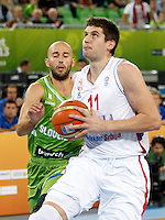 """Djordje Gagic of Serbia in action during European basketball championship """"Eurobasket 2013"""" classification basketball game from 5th to 8th place between Serbia and Slovenia in Stozice Arena in Ljubljana, Slovenia, on September 19. 2013. (credit: Pedja Milosavljevic  / thepedja@gmail.com / +381641260959)"""
