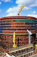 Nuclear reactor vessel under construction at power station. England..