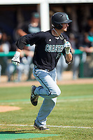 Nick Oberg (16) of the Coastal Carolina Chanticleers hustles down the first base line against the High Point Panthers at Willard Stadium on March 15, 2014 in High Point, North Carolina.  The Chanticleers defeated the Panthers 1-0 in the first game of a double-header.  (Brian Westerholt/Four Seam Images)