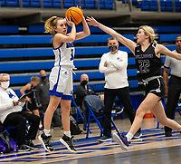 Camiran Brockhoff (3) of Rogers goes up for the 3-point shot, with Carly Johnson (22) of Fayetteville coming in trying to block at King Arena, Rogers, AR January 8, 2021 / Special to NWA Democrat-Gazette/ David Beach