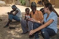 Peace Corps Volunteer Talking with Villagers, Nixo, near Sokone, Senegal