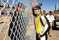 Feb 08, 2009; Daytona Beach, FL, USA; NASCAR Sprint Cup Series driver Paul Menard (right) talks to a crew member during qualifying for the Daytona 500 at Daytona International Speedway. Mandatory Credit: Mark J. Rebilas-