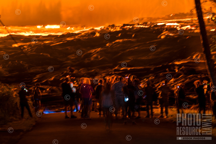 May 2018: Spectators take images or just stand in awe of the Kilauea Volcano eruption in Leilani Estates, Puna, Big Island of Hawai'i.