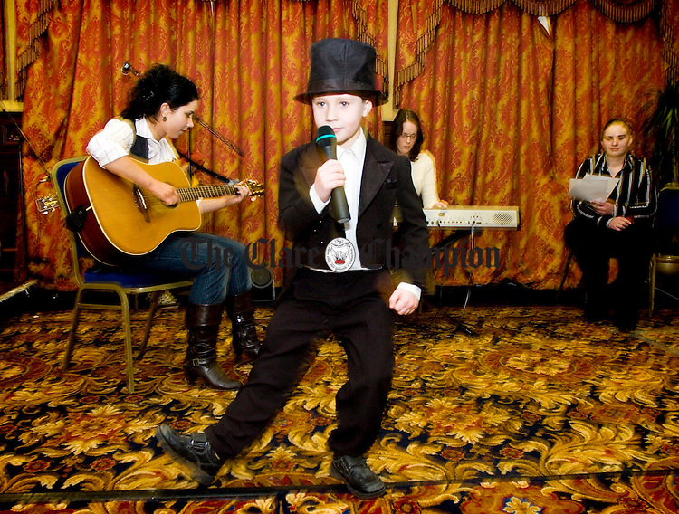 7 year old Davey Keenan entertains members of the travelling community with a song during Traveller Focus Week 2007 at the West County Hotel Ennis.Pic Arthur Ellis.