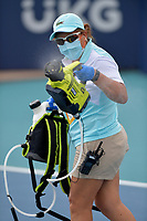MIAMI GARDENS, FL - MARCH 22:  Covid-19 Cleaning Crew seen cleaning and sanitizing courts after players compete in the Qualifying round on day 1 of the Miami Open on March 22, 2021 at Hard Rock Stadium in Miami Gardens, Florida. <br /> <br /> <br /> People:  Covid-19 Cleaning Crew