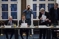 """Runder Tisch zur Versorgung von Fluechtlingen.<br /> Am Montag den 18. Januar 2016 versammelten sich Mitarbeiter verschiedenster gesellschaftlicher Organisationen wie u.a. vom Fluechtlingsrat, kirchlichen Einrichtungen und aus der Politik zu einem """"Runden Tisch zur Versorgung von Fluechtlingen"""". Unter dem Vorsitz von Buergermeister Michael Mueller und dem ehemaligen Innensenator Wolfgang Wieland vom """"Berliner Beirat fuer Zusammenhalt"""" sollte ueber eine Loesung der verschiedensten Probleme im Zusammenhang mit der Aufnahme von Fluechtlingen in Berlin geredet werden. Unter anderem gin es um die Unterbringung von Gefluechteten auf dem Gelaende des ehemaligen Flughafen Tempelhof und einer dafuer vorgeschlagenen Randbebauung.<br /> Im Bild vlnr.: Dieter Glietsch, Staatssekretaer fuer Fluechtlingsfragen; Michael Mueller; und Wolfgang Wieland (rechts stehend am Tisch).<br /> 18.1.2016, Berlin<br /> Copyright: Christian-Ditsch.de<br /> [Inhaltsveraendernde Manipulation des Fotos nur nach ausdruecklicher Genehmigung des Fotografen. Vereinbarungen ueber Abtretung von Persoenlichkeitsrechten/Model Release der abgebildeten Person/Personen liegen nicht vor. NO MODEL RELEASE! Nur fuer Redaktionelle Zwecke. Don't publish without copyright Christian-Ditsch.de, Veroeffentlichung nur mit Fotografennennung, sowie gegen Honorar, MwSt. und Beleg. Konto: I N G - D i B a, IBAN DE58500105175400192269, BIC INGDDEFFXXX, Kontakt: post@christian-ditsch.de<br /> Bei der Bearbeitung der Dateiinformationen darf die Urheberkennzeichnung in den EXIF- und  IPTC-Daten nicht entfernt werden, diese sind in digitalen Medien nach §95c UrhG rechtlich geschuetzt. Der Urhebervermerk wird gemaess §13 UrhG verlangt.]"""