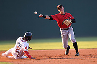 Shortstop Mitch Roman (10) of the Kannapolis Intimidators turns a double play as Santiago Espinal (2) of the Greenville Drive is out in a game on Wednesday, July 12, 2017, at Fluor Field at the West End in Greenville, South Carolina. Greenville won, 12-2. (Tom Priddy/Four Seam Images)