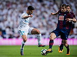 Marco Asensio Willemsen (l) of Real Madrid fights for the ball with Cristian Rivera Hernandez of SD Eibar during the La Liga 2017-18 match between Real Madrid and SD Eibar at Estadio Santiago Bernabeu on 22 October 2017 in Madrid, Spain. Photo by Diego Gonzalez / Power Sport Images