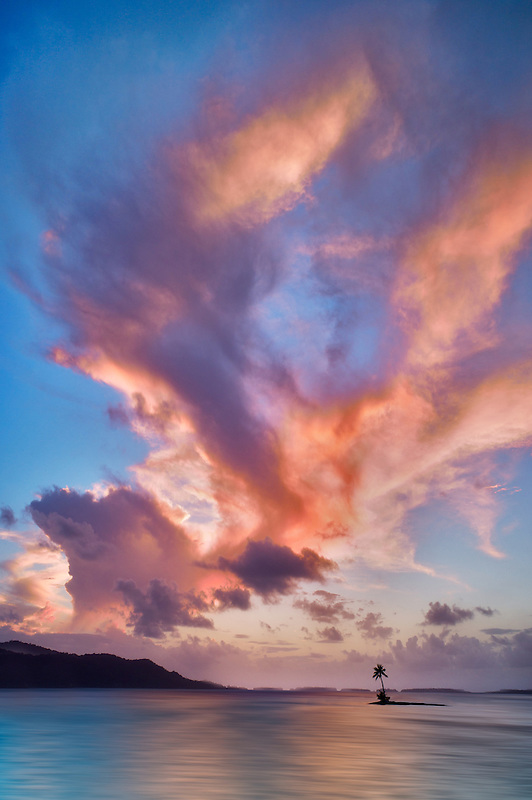 Small island and sunset clouds. Bora Bora. French Polynesia