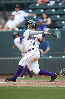 Mitch Roman (4) of the Winston-Salem Dash follows through on his swing against the Salem Red Sox at BB&T Ballpark on April 22, 2018 in Winston-Salem, North Carolina.  The Red Sox defeated the Dash 6-4 in 10 innings.  (Brian Westerholt/Four Seam Images)