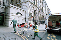 Paramedic ambulance crew taking a patient on a stretcher into a hospital. This image may only be used to portray the subject in a positive manner..©shoutpictures.com..john@shoutpictures.com