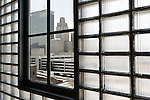 February 18, 2015. Winston Salem, North Carolina.<br />  The Reynolds Building, from which the design for the Empire State Building was taken, can be seen through the window of Wake Forest Biotech Place. The glass bricks surrounding the window, of which there are 65,000 in the facade of the building, were made in 1937 and were part of the original building on the site.<br />  The Wake Forest Innovation Quarter, encompassing 145 developable acres, is an inner city development project focusing on biomedical sciences and information technology. The project is a collaboration between the city of Winston Salem, a private developer and Wake Forest University.The newest building in the $500 million project is a $50 million education building for the university's medical school. Many professional firms have moved into offices in the various buildings of the Innovation Quarter as the city shifts from a tobacco town to one of technological advancement.