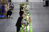 Pictured: James Head with other workers on the assembly line Monday 15 August 2016<br />