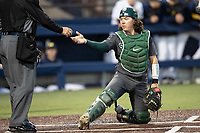 Michigan State Spartans catcher Nic Lacayo (27) reaches for a new baseball from the umpire in the NCAA baseball game against the Michigan Wolverines on May 7, 2019 at Ray Fisher Stadium in Ann Arbor, Michigan. Michigan defeated Michigan State 7-0. (Andrew Woolley/Four Seam Images)