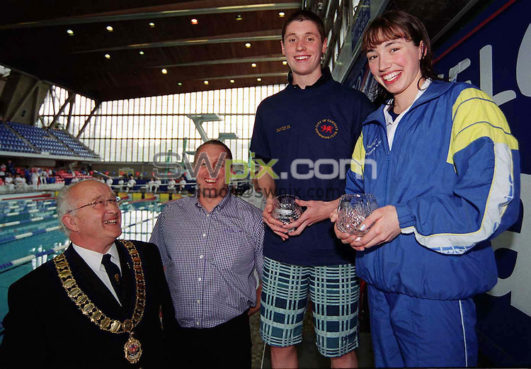 Pix: Matthew Lewis/SWpix.com.  Swimming. The 33rd Speedo Inter League Cup Final.'B' Final. Crystal Palace. 28/04/2002...COPYWRIGHT PICTURE>>SIMON WILKINSON>>01943 436649>>..Tom Little (President of the Southern Counties Amateur Swimming Association) and Duncan Rolley (Sports Promotion manager of Speedo UK), present City of Cardiff's David Davies and City of Leeds Rebecca Shaw with the 'Top Male/Female Swimmer Awards.