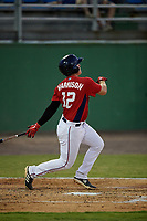 Potomac Nationals KJ Harrison (12) hits a home run during a Carolina League game against the Myrtle Beach Pelicans on August 14, 2019 at Northwest Federal Field at Pfitzner Stadium in Woodbridge, Virginia.  Potomac defeated Myrtle Beach 7-0.  (Mike Janes/Four Seam Images)