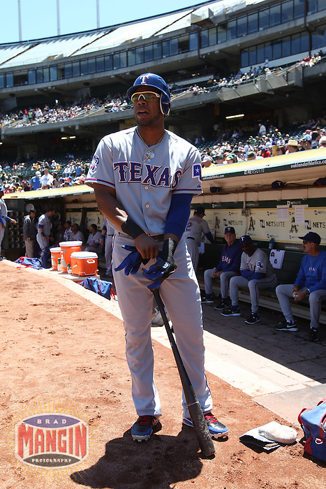 OAKLAND, CA - JUNE 7:  Elvis Andrus #1 of the Texas Rangers leaves the dugout for the on deck circle before the game against the Oakland Athletics at O.co Coliseum on Thursday June 7, 2012 in Oakland, California. Photo by Brad Mangin