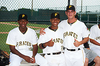 GCL Pirates Julian Villamar (13), Raul Hernandez (34), and Claudio Scotti (17) before a game against the GCL Phillies on August 6, 2016 at Pirate City in Bradenton, Florida.  GCL Phillies defeated the GCL Pirates 4-1.  (Mike Janes/Four Seam Images)