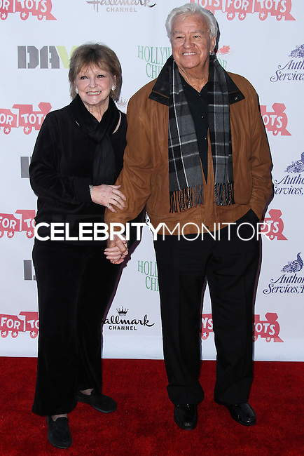 HOLLYWOOD, CA - DECEMBER 01: Kay Knebes, Ron Masak arriving at the 82nd Annual Hollywood Christmas Parade held at Hollywood Boulevard on December 1, 2013 in Hollywood, California. (Photo by Xavier Collin/Celebrity Monitor)