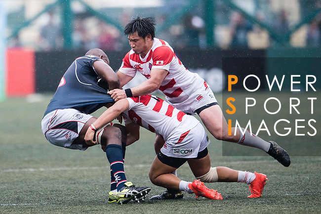 Ryoto Nakamura (R) and Kanta Shikao of Japan (C) puts a tackle on Adrian Griffiths of Hong Kong (L) during the Asia Rugby Championship 2017 match between Hong Kong and Japan on May 13, 2017 in Hong Kong, China. Photo by Marcio Rodrigo Machado / Power Sport Images