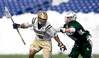 Nikk Davis (6) of Navy is checked by Michael Crimmins (13) of Loyola at the Navy-Marine Corp Memorial Stadium in Annapolis, Maryland.   Loyola defeated Navy, 8-7, in overtime.