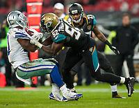 09.11.2014.  London, England.  NFL International Series. Jacksonville Jaguars versus Dallas Cowboys. Dallas Cowboys' Running Back Joseph Randle (#21) is tackled by Jaguars' J.T.Thomas (#52)