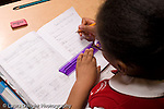 K-8 Parochial School Bronx New York Grade 3 mathematics lesson on measurement girl using ruler at desk horizontal