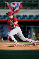 Palm Beach Cardinals third baseman Evan Mendoza (4) follows through on a swing during a game against the Florida Fire Frogs on May 1, 2018 at Osceola County Stadium in Kissimmee, Florida.  Florida defeated Palm Beach 3-2.  (Mike Janes/Four Seam Images)