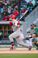 Andrew Knizner (11) of the North Carolina State Wolfpack follows through on his swing against the Charlotte 49ers at BB&T Ballpark on March 31, 2015 in Charlotte, North Carolina.  The Wolfpack defeated the 49ers 10-6.  (Brian Westerholt/Four Seam Images)