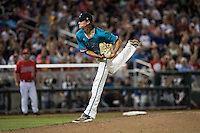 Bobby Holmes #31 of the Coastal Carolina Chanticleers pitches during a College World Series Finals game between the Coastal Carolina Chanticleers and Arizona Wildcats at TD Ameritrade Park on June 28, 2016 in Omaha, Nebraska. (Brace Hemmelgarn/Four Seam Images)