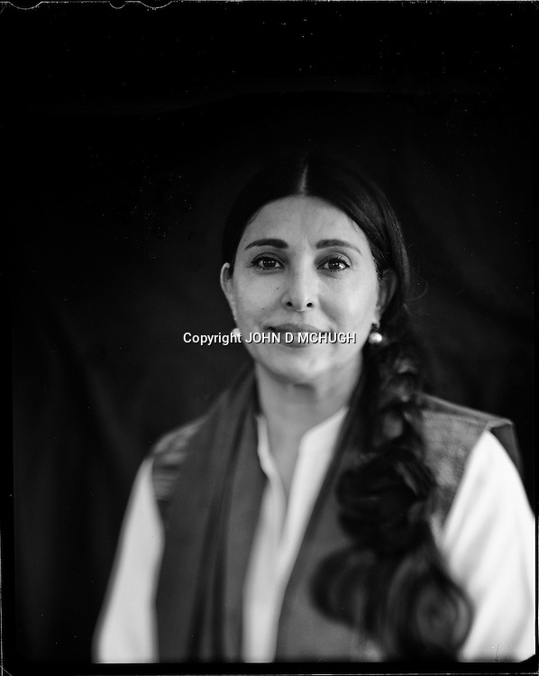 "Hassina Sherjan, business woman, is seen at her textile factory in Kabul, 31 August 2012. This portrait was shot on a 5x4 Linhof Technika IV, circa 1959, and a Schneider Kreuznach 270mm lens, circa 1952, with front tilt, and is part of a series entitled ""Putting an Afghan face on the war."" (John D McHugh)"