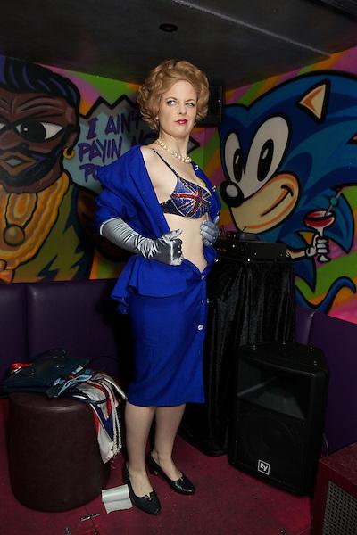 Margaret Thatcher impersonator Honey Wilde stripping at Maggies Nightclub in Chelsea