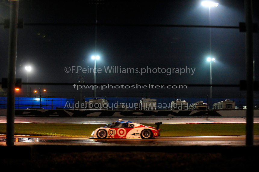 The #01 Chip Ganassi Racing Lexus/Riley of Juan Pablo Montoya, Scott Pruett, Dario Franchitti and Memo Rojas speeds to victory.