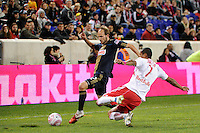 Roy Miller (7) of the New York Red Bulls goes in for a tackle on Justin Mapp (22) of the Philadelphia Union. The New York Red Bulls defeated the Philadelphia Union  1-0 during a Major League Soccer (MLS) match at Red Bull Arena in Harrison, NJ, on October 20, 2011.