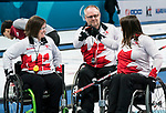 PyeongChang 14/3/2018 - Fish bumps as Canada takes on Slovakia in wheelchair curling at the Gangneung Curling Centre during the 2018 Winter Paralympic Games in Pyeongchang, Korea. Photo: Dave Holland/Canadian Paralympic Committee