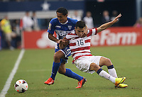 Jose Torreso #16 of the USMNT in action against  Andy Najar #14 of Honduras on July 24, 2013 at Dallas Cowboys Stadium in Arlington, TX. USMNT won 3-1.