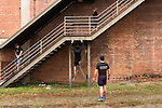 December 22, 2014. Lexington, North Carolina.<br />  (left to right) Stan Lanier, Chris Phelps, Nicole Smith and Mayor Newell Clark use a factory staircase as part of their exercise routine.<br />   Newell Clark, the 43 year old mayor of Lexington, NC, leads a group of friends and colleagues on a 4 times a week exercise routine around downtown. The group uses existing infrastructure, such as an abandoned furniture factory, loading docks, stairs, and handrails to get fit and increase awareness of healthy lifestyles in a town more known for BBQ.<br /> Jeremy M. Lange for the Wall Street Journal<br /> Workout_Clark