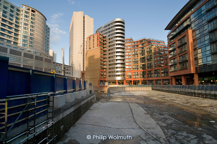 Section of the GRand Union canal drained for new construction work by the Hilton London Metropole hotel and the West End Quay development at Paddington Basin