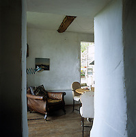 This glimpse into the dining room reveals the thickness of the walls of the house